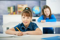 Schoolgirls in primary school classroom Royalty Free Stock Photo