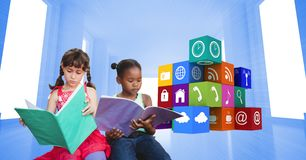 Schoolgirls reading books by apps icons Royalty Free Stock Photos
