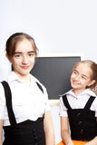 Schoolgirls and schoolboard Royalty Free Stock Photos