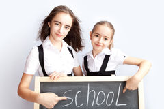Schoolgirls about a schoolboard Royalty Free Stock Photo