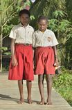 Schoolgirls in scooluniform. Royalty Free Stock Image