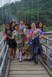 Schoolgirls are smiling on the bridge in small Royalty Free Stock Photo
