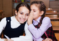 Schoolgirls speak in the classroom royalty free stock photography