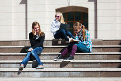 Schoolgirls on the steps Stock Photo