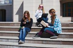 Schoolgirls on the steps Royalty Free Stock Photos