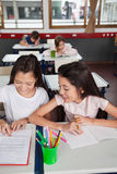 Schoolgirls Studying Together In Classroom Royalty Free Stock Image