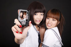 Schoolgirls taking self-portrait Stock Image