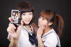 Schoolgirls taking self-portrait Stock Image