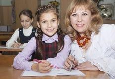 Schoolgirls and teacher Stock Images