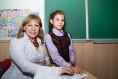 Schoolgirls and teacher Royalty Free Stock Images