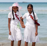 Schoolgirls in uniform hand in hand Royalty Free Stock Images