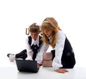 Schoolgirls In Uniform With Laptop. Stock Image