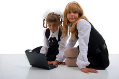Schoolgirls In Uniform With Laptop. Royalty Free Stock Photography