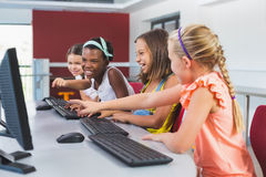 Schoolgirls using computer in classroom Stock Photography