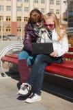Schoolgirls using laptop Royalty Free Stock Photos