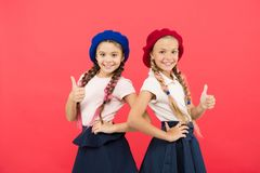 Schoolgirls wear formal uniform and beret hats. Elite school college. Education abroad. Apply form enter international. School. Sisters friends girls. French stock images