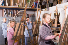 Schoolgirls and  women draw Stock Photo