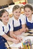 Schoolgirls in woodwork class. Smiling stock photo