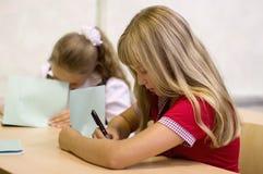 Schoolgirls writing stock photo