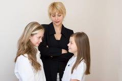 schoolgirlsteache två Fotografering för Bildbyråer