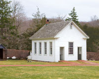 Schoolhouse. A simple, white one room schoolhouse Stock Photos