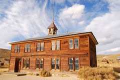 Schoolhouse at Bodie. The schoolhouse looks great with the sky as a background Royalty Free Stock Photos