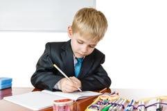 Schooljongen stock afbeeldingen