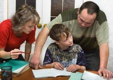 Schooljongen en ouders Royalty-vrije Stock Afbeeldingen