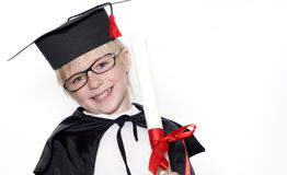 Schooljongen in graduatie GLB Stock Foto's