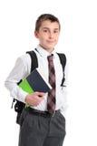 Schooljongen met boeken en rugzak stock fotografie