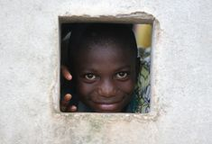 Schoolkid. Kid in suriname, at school. boy looking through wall at school, paramaribo Stock Images