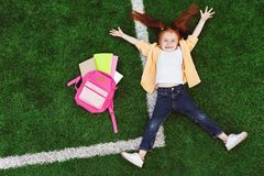 Schoolkid with backpack on grass Stock Image