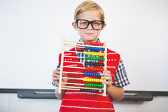 Schoolkid pretending to be a teacher. Portrait of schoolkid pretending to be a teacher in classroom at school Royalty Free Stock Images