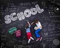 2 schoolkids уча Стоковое Изображение RF