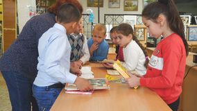 Schoolkids with books stand next to the teacher`s desk. Chapaevsk, Samara region, Russia - May 10, 2019: Elementary school of the city of Chapaevsk. Schoolkids stock video