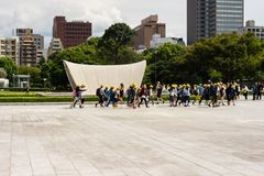 Schoolkids on excursion in Japan. Hiroshima Peace Park, Hiroshima royalty free stock photo
