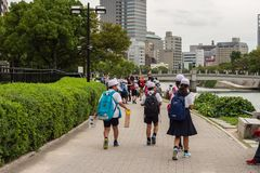 Schoolkids on excursion in Japan. Hiroshima Peace Park, Hiroshima stock photography