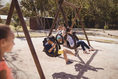 Schoolkids playing in playground Stock Photos