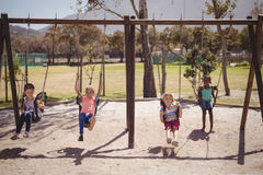 Schoolkids playing in playground Royalty Free Stock Images
