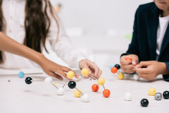 Schoolkids working with molecular model at chemistry lesson Stock Images