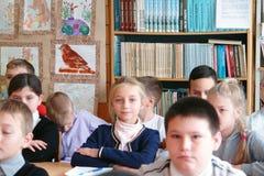 Schoolkinderen in klaslokaal Royalty-vrije Stock Foto's