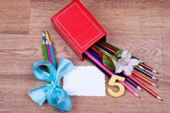 Schoollevering op een houten achtergrond Stock Foto