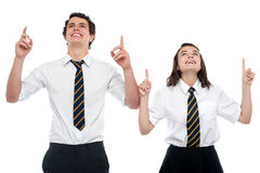 Schoolmates looking and pointing upwards Stock Images