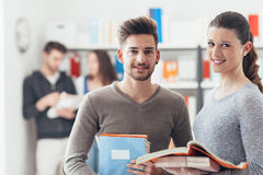 Schoolmates posing with books Stock Photography
