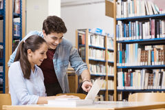 Schoolmates studying together at the library Stock Image