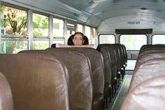 Schoolmeisje in bus royalty-vrije stock afbeeldingen