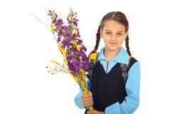 Schoolmeisje in eerste dag van school stock foto's