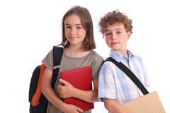 Schoolmeisje en Schooljongen Stock Foto's