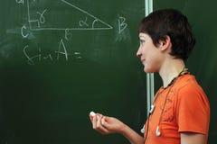 Schoolmeisje. Les van math royalty-vrije stock foto