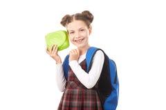 Schoolmeisje met lunchbox stock fotografie